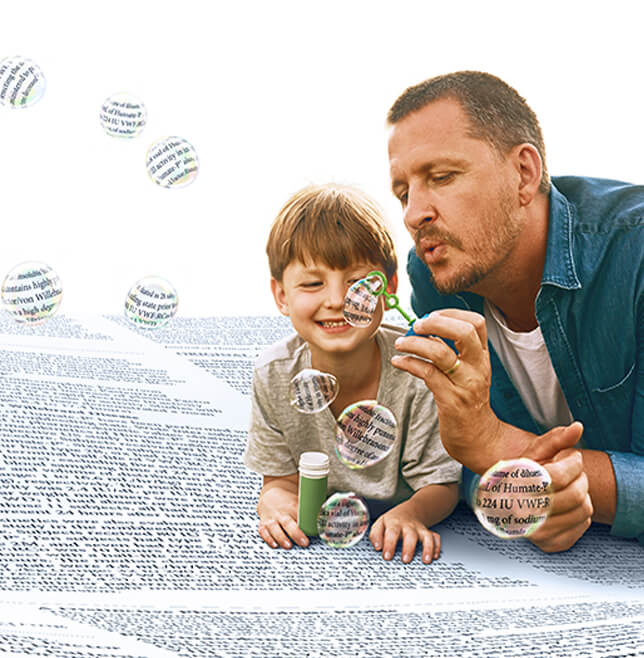 man and child blowing bubbles
